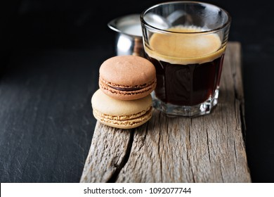 Chocolate and coffee macarons with espresso in a glass