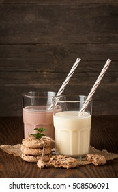Chocolate, coffee, milk, banana shake on wooden background. Smoothie with cookies. Milkshake. Protein diet. Healthy food concept.