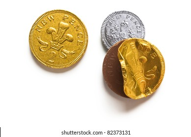 Chocolate Coins isolated on white background with shadow