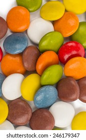 chocolate colored buttons on a white background