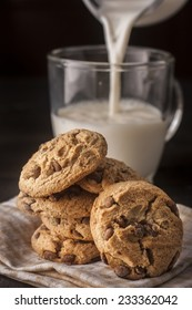 chocolate cookie with milk on wooden table