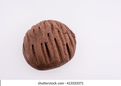 Chocolate cookie with a pattern on a white background