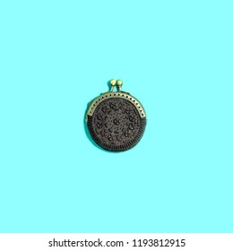 Chocolate cookie as purse. Combining different objects. Minimal style. Creative idea, imagination and fantasy. Original food concept