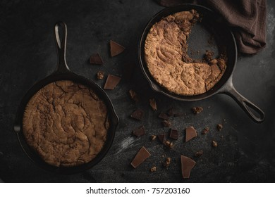 Chocolate cookies baked in a cast iron skillet.