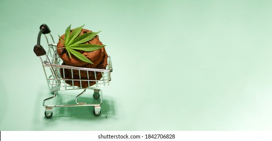 Chocolate cookies with CBD oil in shopping cart. Cannabis food banner. Marijuana leaf. Alternative medicine. Online purchase. Copy space
