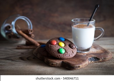 Chocolate cookies with colorful candies on the top
