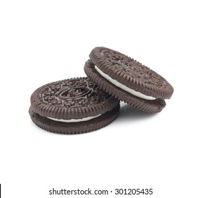 Chocolate cookies with cream filling isolated on white background.
