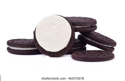 Chocolate cookies with cream filling tower isolated on white background.