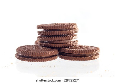 Chocolate cookies with cream filling tower isolated on white background