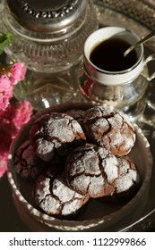 Chocolate cookies, cup of coffie,flowers on silver tray