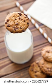 the chocolate cookies and milk in jar