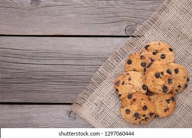 Chocolate cookies on grey sackcloth. Chocolate chip cookies on grey sackcloth background