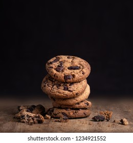 Chocolate cookies on rustic wood table. Chocolate chip cookie on black  background with copy space for text, closeup.