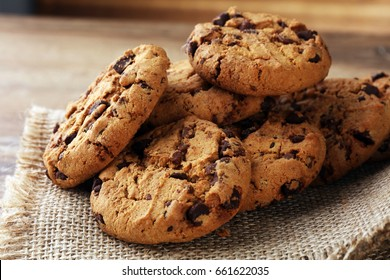 Chocolate cookies on wooden table.
