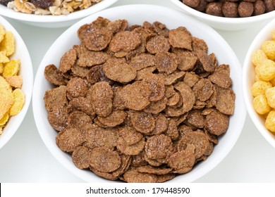 chocolate cornflakes and breakfast cereals, top view, close-up