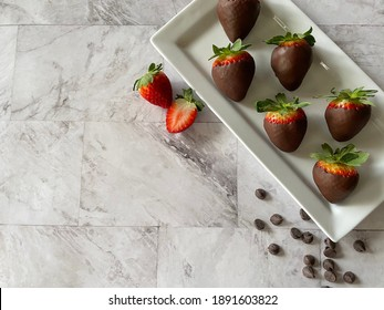 Chocolate covered and chocolate drizzled strawberries