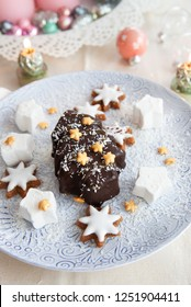 Chocolate covered ice cream in a Christmas tree shape with coconut