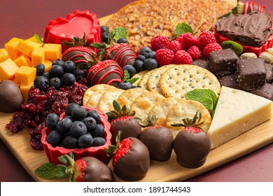 Chocolate Covered Strawberries and Cheese Sweet Charcuterie Board on a Red Table