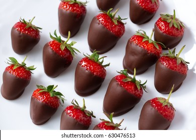 Chocolate covered strawberries on a white plate