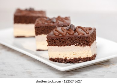 Chocolate and cream cake on plate