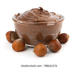Chocolate cream with hazelnuts in a bowl isolated on white background