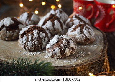 Chocolate Crinkle Cookies  in powdered sugar and Christmas decoration, rustic style