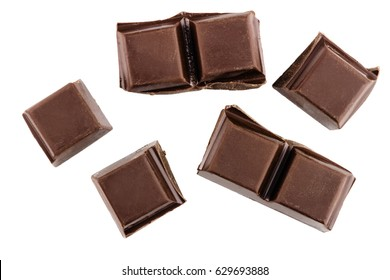 Chocolate cubes, pieces of bitter, dark chocolate bar, isolated on white background, top view.