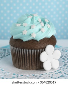 chocolate cupcake with blue frosting with white stars