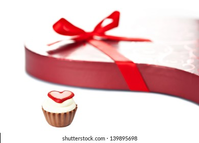 Chocolate cupcake bonbon with heart and red heart-shaped box with ribbon bow. More Valentine theme images in my portfolio