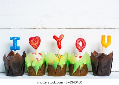 chocolate cupcake with a candle in the shape of  heart I LOVE YOU. Happy Valentines Day