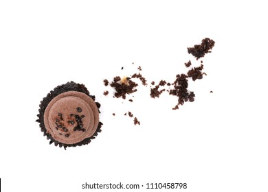 chocolate cupcake with crumbs isolated on white background food concept