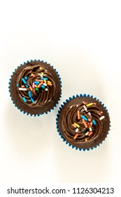Chocolate cupcake isolated on white background. Top view