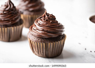 chocolate cupcake on marble background
