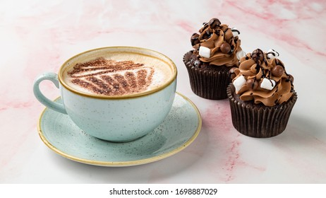 Chocolate Cupcakes With Cappuccino On Pink Marble Surface