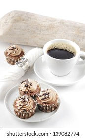 Chocolate cupcakes and a cup of coffee