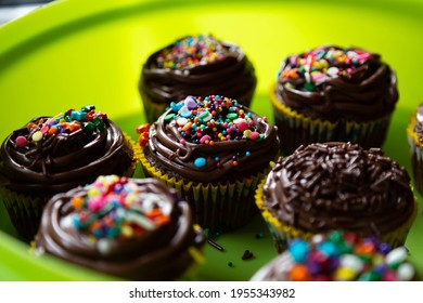 Chocolate cupcakes decorated with birthday party sprinkles