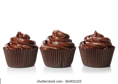 Chocolate cupcakes isolated on white