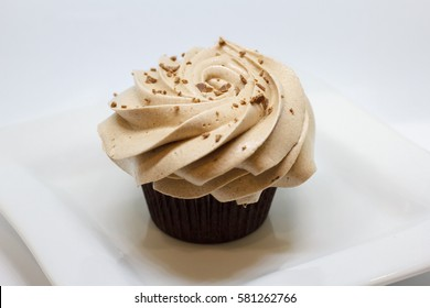 Chocolate cupcakes isolated on white. Selective focus