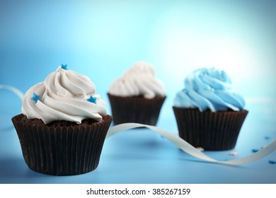 Chocolate cupcakes on blue background