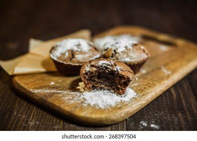 chocolate cupcakes on the wooden desk