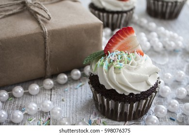 Chocolate cupcakes with white creme and strawberry on top