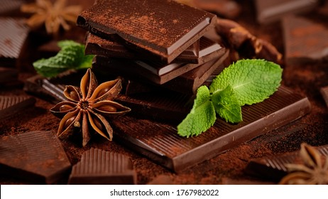 chocolate. dark chocolate bar stack and cocoa powder with mint leaf. Confectionery, confection concept