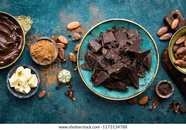 Chocolate. Dark bitter chocolate chunks, cacao butter, cocoa powder and cocoa beans. Chocolate background