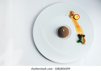 Chocolate dessert presentation on a big white plate