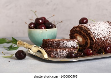 chocolate dessert roll with vanilla cream and sweet cherry
