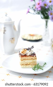 Chocolate dessert with tea, violet flowers and napkin