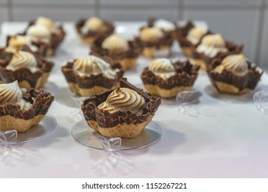 Chocolate dipped cups filled with toasted meringue.