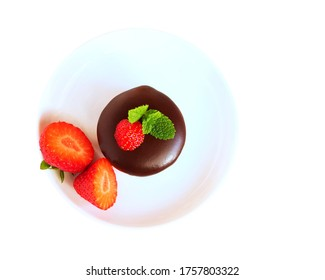 Chocolate dipped sandwich cookies with strawberries on white plate isolated, top view, flat lay
