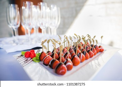 Chocolate dipped strawberries served at an event catering party