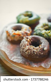 Chocolate donut in pastry cafe.Delicious Dutch doughnuts baked in pastry cafeteria.Bakery products in close up.Enjoy sweet dessert food for lunch meal on coffee break.Tasty doughnut set fried in oven